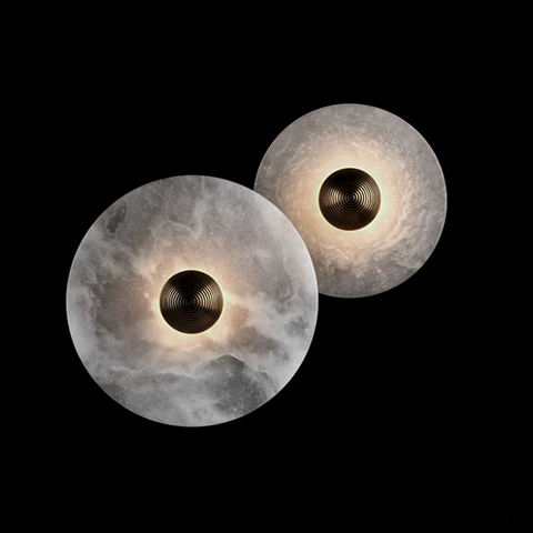 both sizes of the apparatus median sconces on a black background