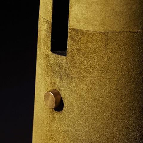 close up of apparatus metronome floor lamp