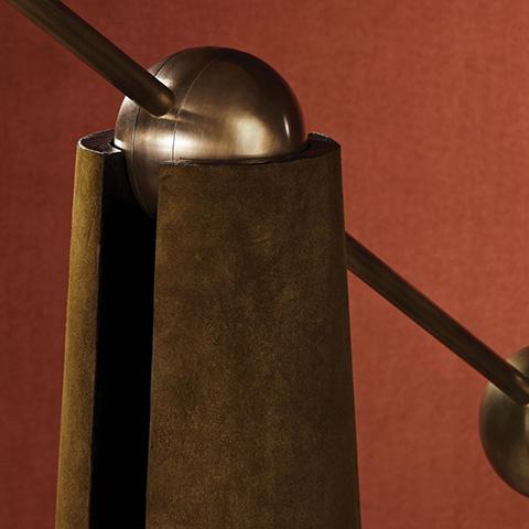 close up of apparatus metronome articulating floor lamp