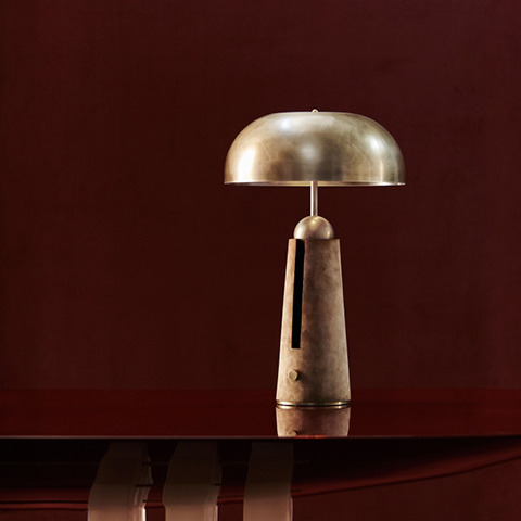 apparatus metronome table lamp in a red room