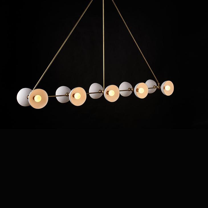 apparatus trapeze 10 pendant light on a black background