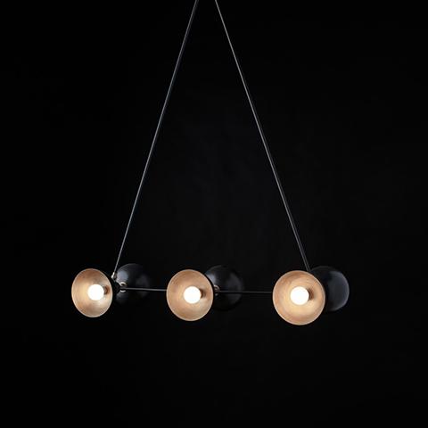 apparatus trapeze 3 pendant light on a black background