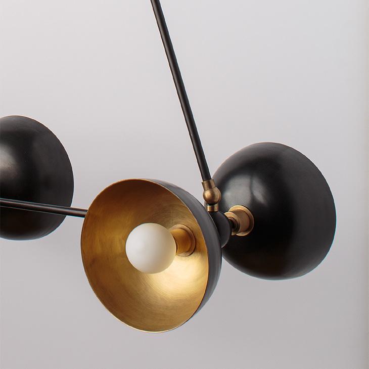 close up of apparatus trapeze pendant light