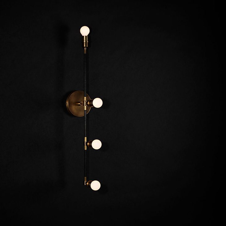 apparatus vanity sconce on a black background