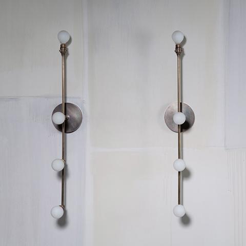 two apparatus vanity sconces in situ