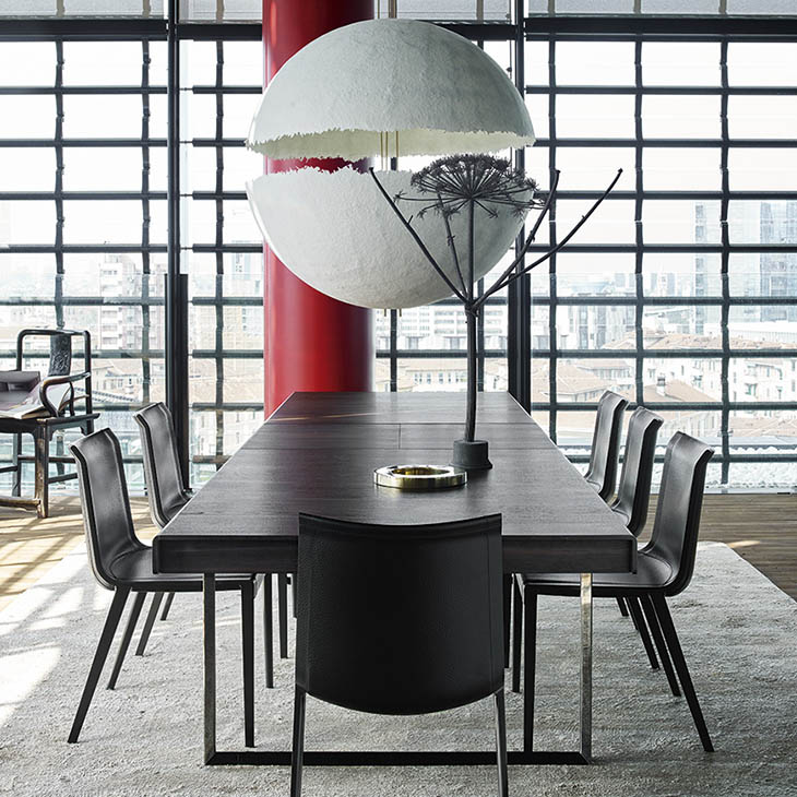 contemporary dining room featuring b&b italia charlotte chairs