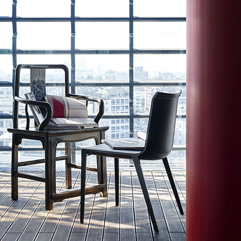 contemporary dining room featuring b&b italia charlotte chair