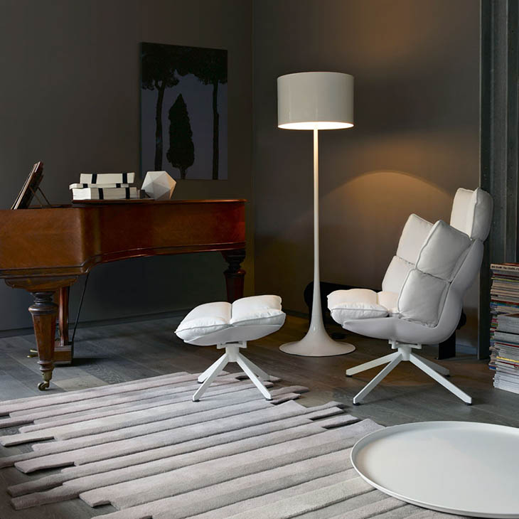 modern living room featuring b&b italia husk armchair and ottoman with white metal base