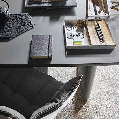 bird's eye view of b&b italia tobi-ishi table and husk chair in an office setting