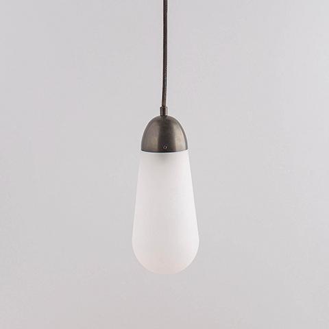 apparatus lariat pendant light on a soft grey background
