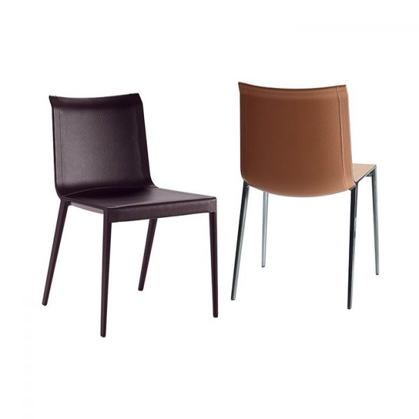 two b&b italia charlotte chairs on a grey background