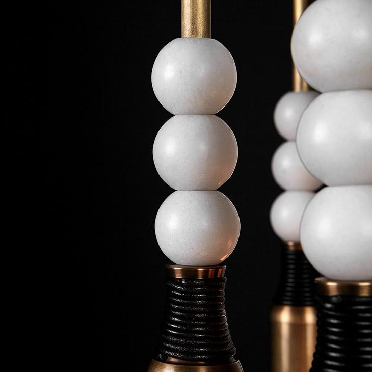 close up of decorative stone balls on apparatus talisman pendant