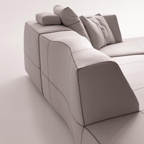 b&b italia bend sofa on a neutral background