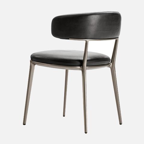 b&b italia caratos chair on a grey background