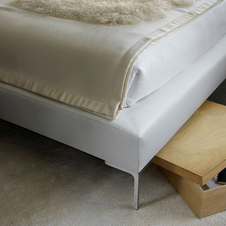 detail of b&b italia charles bed with extended sides