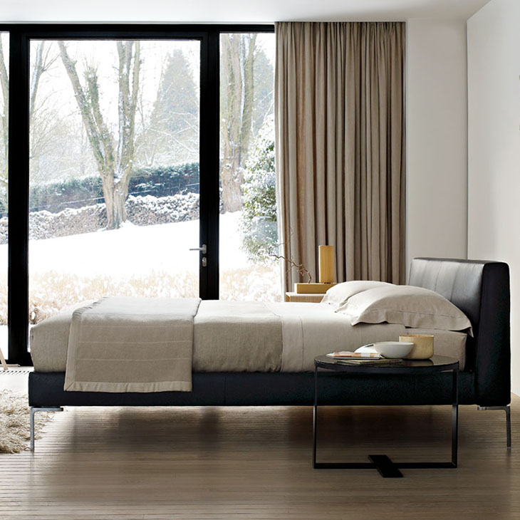 modern bedroom featuring b&b italia charles bed with flush sides