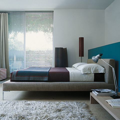 modern bedroom featuring b&b italia charles bed with extended sides
