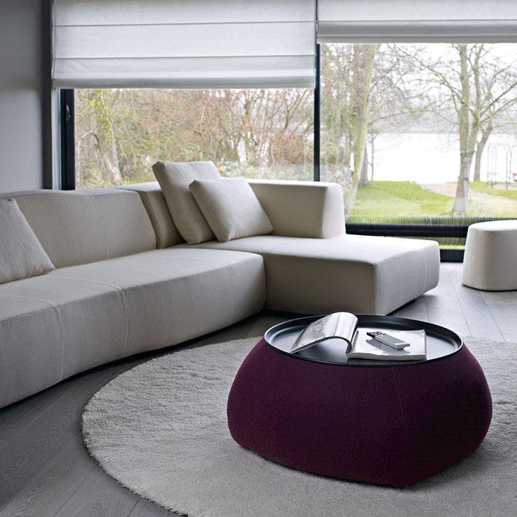 modern living room featuring a b&b italia fat fat ottoman