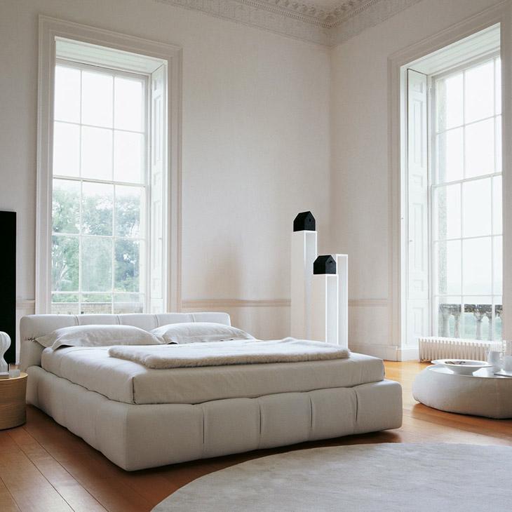 modern bedroom featuring a b&b italia fat fat ottoman