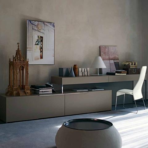 modern home office featuring a b&b italia fat fat ottoman