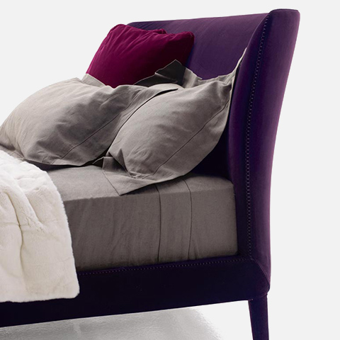 3/4 view of b&b italia febo bed on a white background