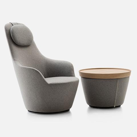 grey b&b italia harbor armchair and ottoman on a grey background