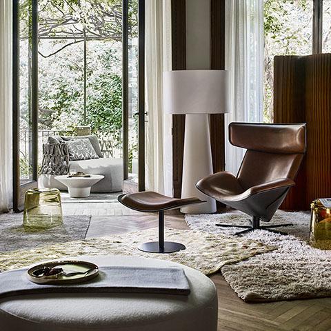 modern living room featuring a b&b italia harry large ottoman