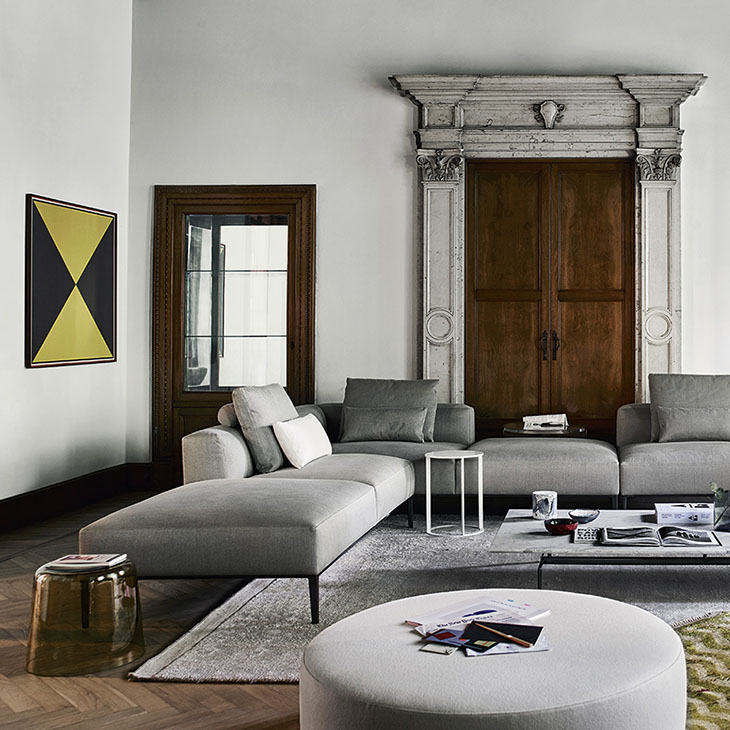 modern living room in a historic house featuring a b&b italia harry large ottoman