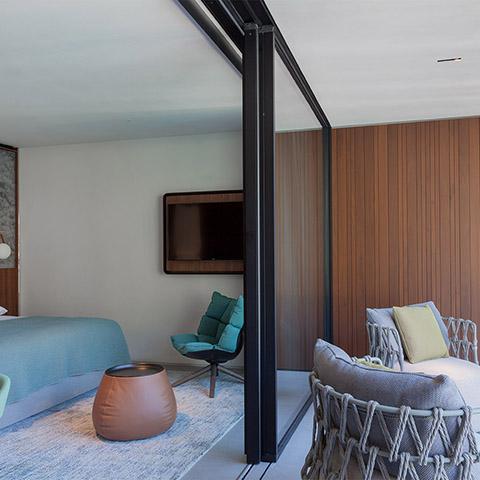 modern bedroom and patio featuring b&b italia husk armchair wood base