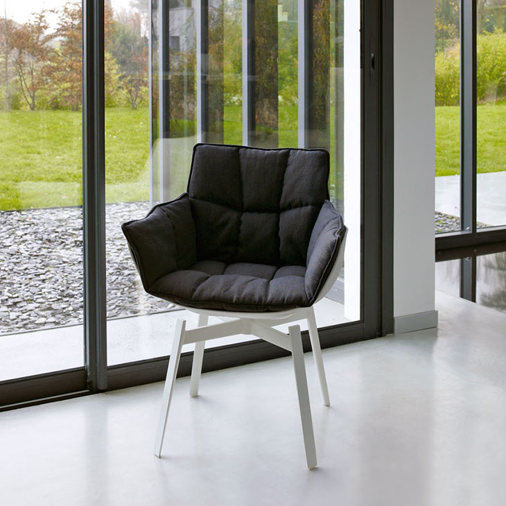 interior space featuring b&b italia husk chair with white painted metal base