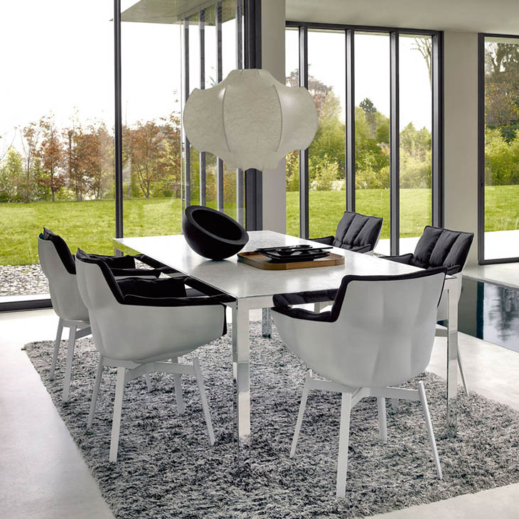 dining room featuring b&b italia husk chairs with white metal base