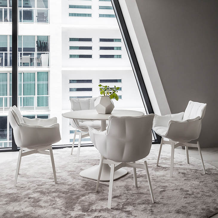 dining room featuring b&b italia husk chairs with metal base