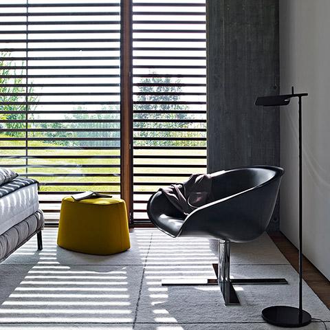 modern bedroom featuring b&b italia mart armchair