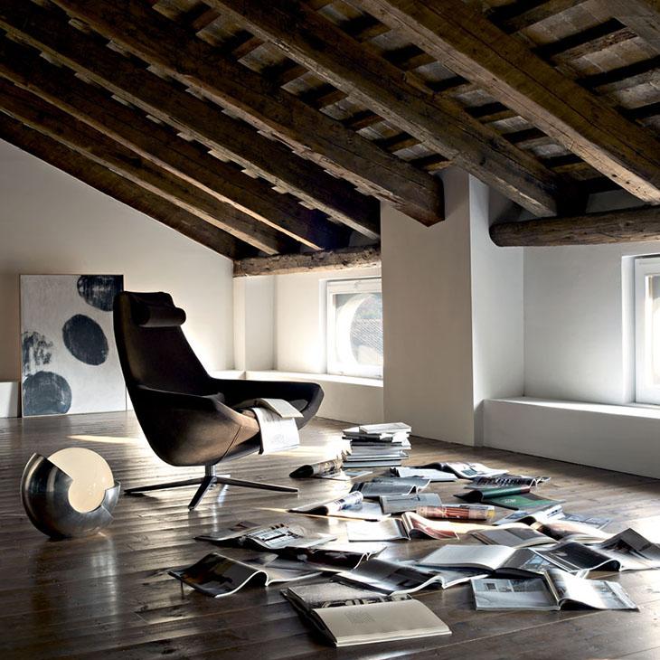 modern loft space featuring b&b italia metropolitan armchair