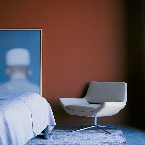 modern bedroom featuring b&b italia metropolitan armchair