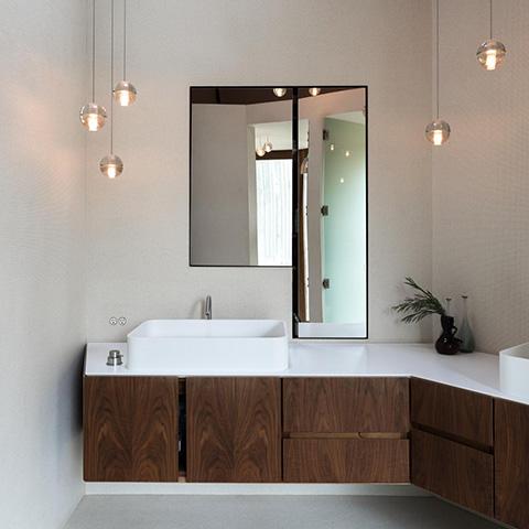 modern bathroom featuring bocci 14 series pendant lights