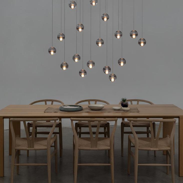 scandinavian style dining room featuring bocci 14 series pendant light
