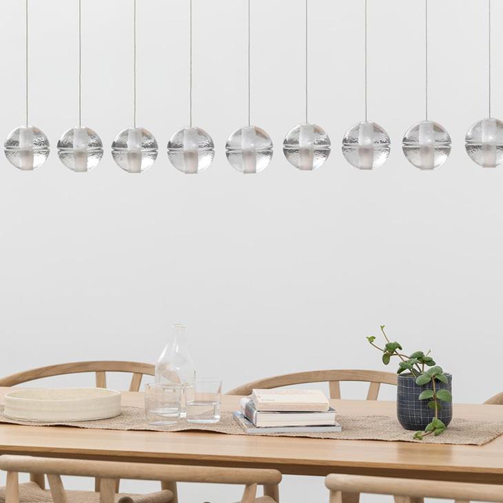 modern dining room featuring bocci 14 series pendant light