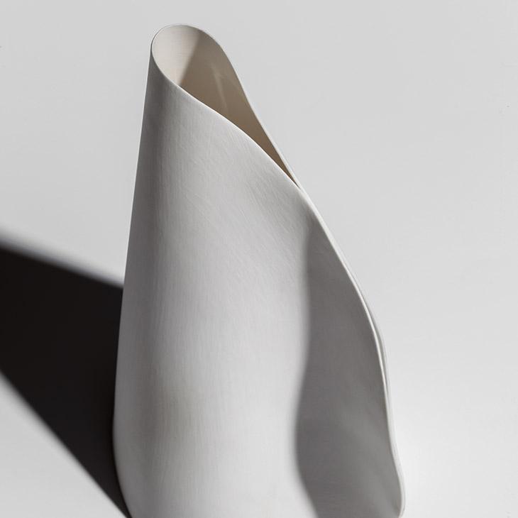 close up of porcelain form of bocci 21 series pendant light