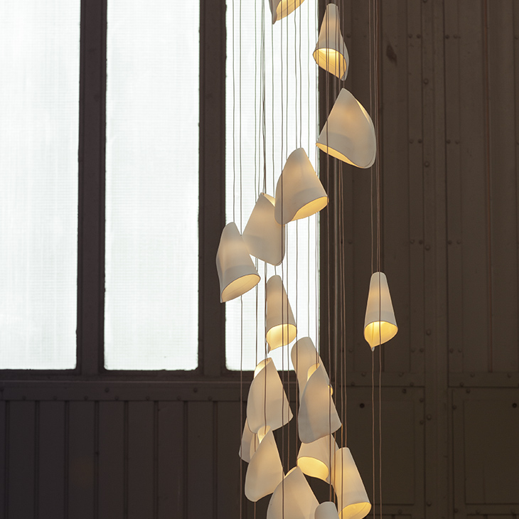 interior space featuring bocci 21 series pendant light