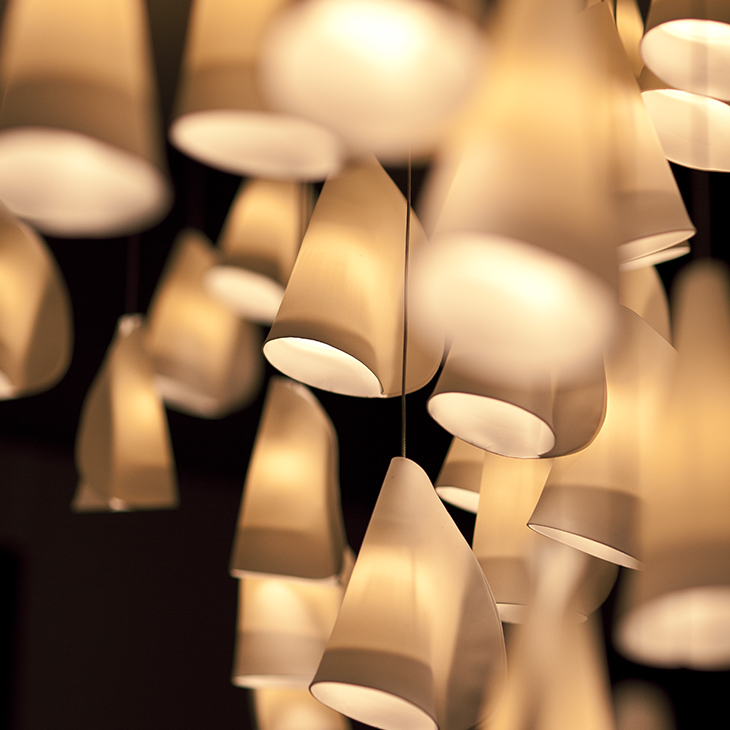 close up of multiple porcelain forms of a bocci 21 series pendant light