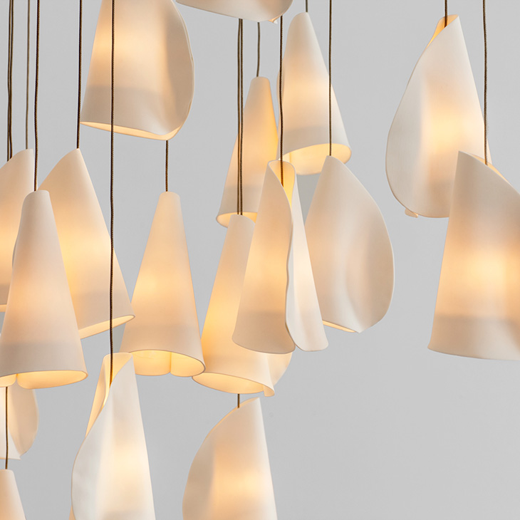 close up of porcelain forms of the bocci 21 series pendant light