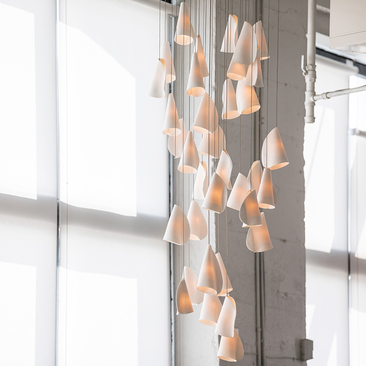 modern industrial space featuring bocci 21 series pendant light