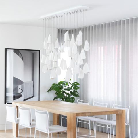 modern dining room featuring bocci 21 series pendant light