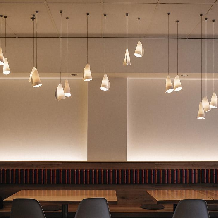 modern restaurant featuring bocci 21m pendant lights