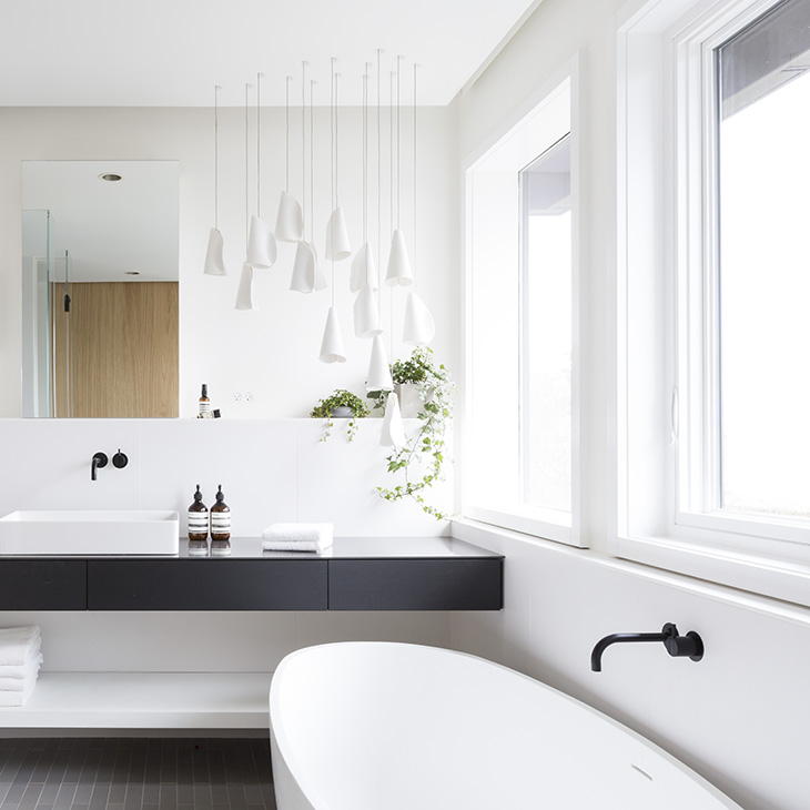 modern bathroom featuring bocci 21m pendant lights