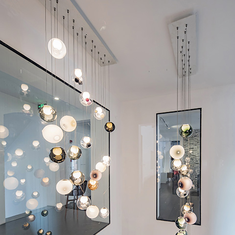 stairwell featuring bocci 28 series pendant light