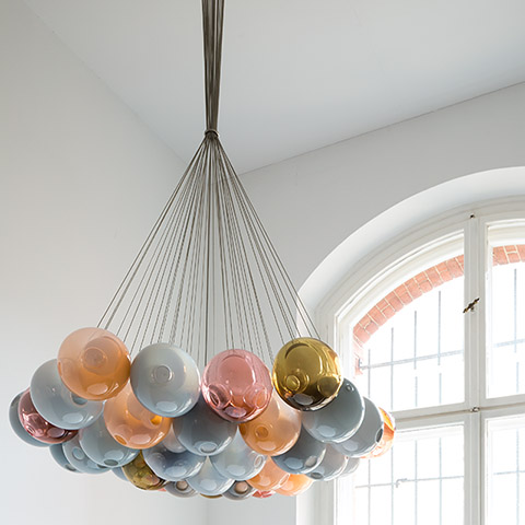 colorful bocci 28 series cluster pendant light in a white room