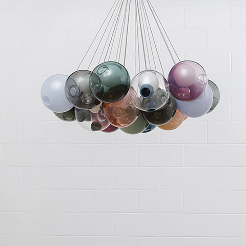 colorful bocci 28 series pendant lights on a white brick background