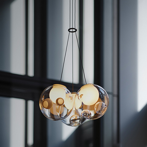 bocci 28.3 cluster pendant light glowing against a dark background